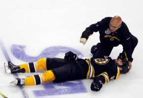 The Boston Bruins' Nathan Horton lies injured on the ice after being hit by the Vancouver Canucks' Aaron Rome during the first period in Game 3 of the Stanley Cup hockey playoff in Boston